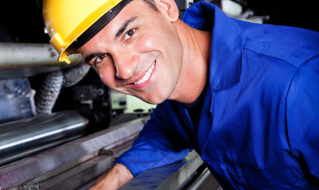 happy industrial machine operator